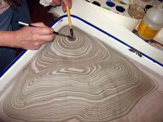Suminagashi: the process of floating ink on a tray of water: paper marbling