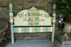 Old headboard turned welcoming sign - what fun for a front porch!
