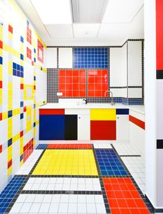 How crazy fun is this DeStijl inspired tile kitchen using classic Destijl colors red, blue, and yellow. #TileSensations