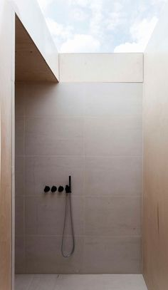 Bathroom Tile Ideas - Use Large Tiles On The Floor And Walls // The large tiles on the wall of this bathroom shower help make the space feel open, while the light color of them reflects the natural light helping to keep the shower area bright.