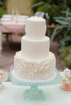 Brides: Three-Tiered White Cake with Flowers. A three-tier white wedding cake with sugar flowers, created by Brooklyn Girl Bakery.