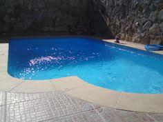Madrid - Parque Coimbra  Esta piscina fué realizada a medida lo más ajustada a las paredes de los vecinos y a la parte de la entrada de la casa,se construyo a medida llegandole a ganar medio metro más de lo que en un principio habiamos programado,la piscina es en acero galvanizado spectron, el acabado interior es en azul dando a destacar la cenefa que rodea la piscina.  http://www.aquazonepiscinas.es/construccion-de-piscinas/madrid-parque-coimbra