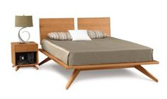With its deeply splayed legs producing dramatic cantilevers, the Astrid Bedroom is an engineering feat that defies expectations and inspires a sense of possibility. Astrid may be ordered without or with 1 or 2 headboard panels. The collection is crafted in solid cherry hardwood and is Made to Order in several finishes with a variety of knob or pull options. The Astrid Bedroom is also crafted in a combination of solid walnut and dark chocolate maple or solid maple with several finish options.