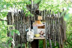 Move over kids, I think I need to play in this tree house with the fringed light shade.