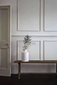 white moulding & rustic bench