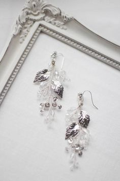 More items from my shops: https://www.etsy.com/shop/EnzeBridal https://www.etsy.com/shop/EnzeBridalUSA These floral flower chandelier leaf and crystal decorated statement earrings will be a perfect match or can easily be customized to match my other halos, hair vines, headpieces, hair