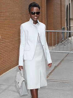 "Lupita Nyong'o kept her look neutral for ""The View,"" flaunting a light gray get-up, a matching tote and chic jet black sunnies!"