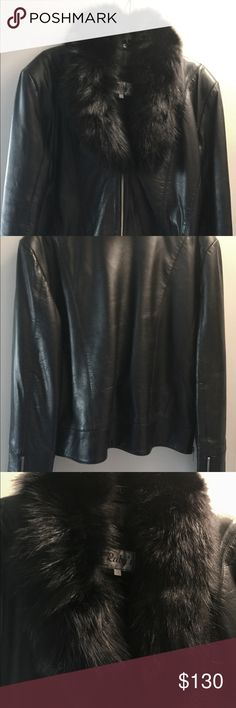 Black leather jacket with fox collar Buttery soft waist length leather jacket. Zip closer, zipper details on end of sleeves and each side, detachable genuine fox collar, removable warm quilted lining. In really great condition, no stains, no tears, no holes, no funny smells, one missing button. Very versatile, chic and stylish. Ruby's Leathers Jackets & Coats