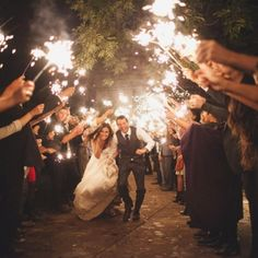 Sparklers!!  Can't decide if I should have a traditional daytime wedding with birdseed, or a nighttime wedding with sparklers??