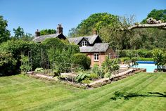 Half an acre of landscaped gardens, complete with heated swimming pool. This stunning property is located in the heart of the New Forest National Park in Hampshire.