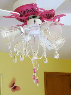 Sure, I'd love to get rid of the ceiling fan all together, but that's just not practical.This is a great compromise between a fan and a pretty chandelier for a girls bedroom :) Candace Creations: Pink Ceiling Fan Chandelier Makeover Pink Ceiling Fan, Girls Ceiling Fan, Ceiling Fan Chandelier, Ceiling Fans, White Ceiling, Girls Chandelier, Chandelier Crystals, Star Ceiling, Chandelier Ideas