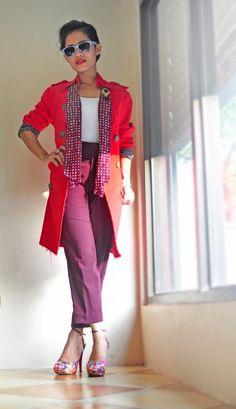 BERRY HUES!  Frayed red coat, polka dot scarf, maroon pants and stripey shades.