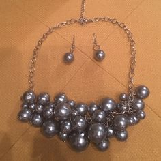Gray Faux Pearl Cluster Necklace & Earrings This beautiful necklace & earring set is the perfect addition to your work wardrobe. Pair with a black dress or a crisp white blouse. Jewelry