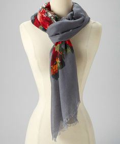Wrap up in warmth with this all-cotton scarf that features a pretty print.
