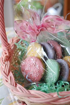 Golden Oreo Eggs--top is dipped in colored white chocolate. It would also be cute to dip the whole cookie and stick a skewer in it. Cookie pop!