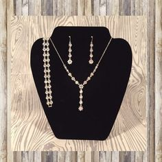 Necklace Set Beautiful, sparkling necklace, bracelet and earring set. Necklace can be adjusted from 9 to 10 inches long. Jewelry Necklaces