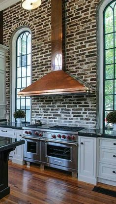 Amazing copper vent hood looks fabulous against the brick wall. depends on color of brick!! as well