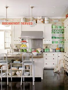 Nice bright kitchen.  Love the green dishes on the open shelves.
