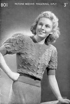 1940's ladies puff sleeve knitted jumper with button front and lace work.