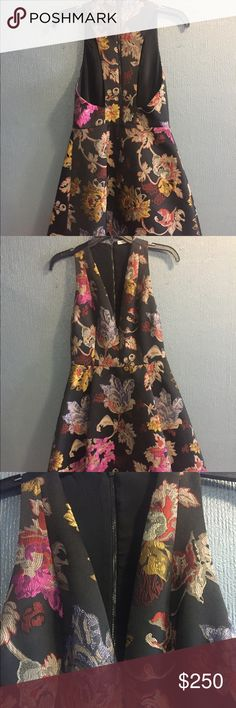 Alice + Olivia Party Dress Vivid floral party dress in Size 4. Low front cut and back zipper. BEAUTIFUL...Never used. Alice & Olivia Dresses Midi