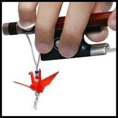 The origami (folded paper) crane hovers and soars IF the player& little finger is resting on the bow. If not--Crane will be on the floor! Violin Instrument, Violin Bow, Cello, Violin Store, Violin Music, Teaching Orchestra, Teaching Music, Violin Lessons, Music Education