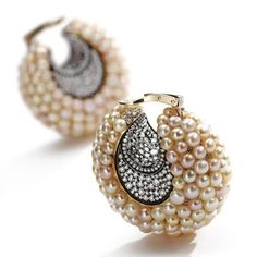 Pair of natural button pearl and diamond 'Creoles-Croissant' earclips, JAR, Paris    The bombé crescents composed of numerous natural button pearls, the centers and below the pearls set with numerous round diamonds weighing approximately 7.85 carats. With signed box. Estimate 50,000—70,000 USD - Lot Sold 110,500 USD