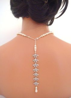Bridal backdrop necklace bridal pearl necklace by treasures570, $95.00. I have some bacne I need to clear up before I could rock this at my wedding parties.