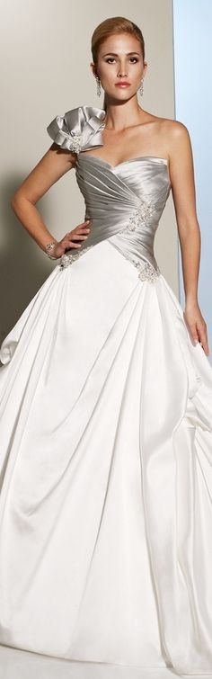 Wow!!! Something about this gown is absolutely stunning. Maybe it's the silver & white color combination, the mixing of silk & satin or the asymmetrical design. Either way it's such a memorable gown!