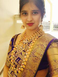 Bride in dark blue saree and mango mala and varalamala