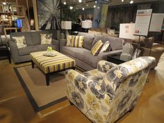 Grey and yellow. Here's another look of a stunning living room set in this trend. Also... A fun patterned chair. 2013 Fall High Point Furniture Market Trends by: Asia Evans Artistry for Manteo Furniture #HPMKT