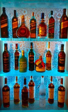 LED Glass bar shelving for your liquor! Studio L Glassworks Bookshelf Bar, Bar Shelves, Glass Corner Shelves, Glass Shelves Kitchen, Liquor Storage, Diy Home Bar, Man Cave Room, Bar Interior Design, Bottle Display