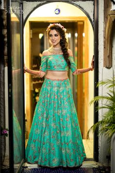 Looking for Turquoise green mehendi lehenga? Browse of latest bridal photos, lehenga & jewelry designs, decor ideas, etc. on WedMeGood Gallery. Indian Wedding Gowns, Indian Wedding Hairstyles, Indian Dresses, Indian Outfits, Gown Wedding, Off Shoulder Lehenga, Hairstyles For Gowns, Hairstyles With Lehenga, Bride Hairstyles