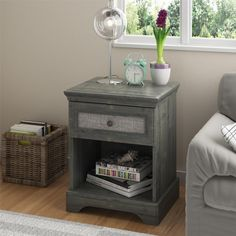 This alluring nightstand from Altra features a fabric panel insert in the drawer and a rustic grey oak finish for a distinctive mix of textures in the bedroom. Great in any interior, from classic to ultra-chic.