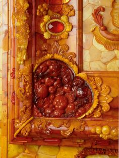 THE AMBER ROOM~ CATHERINE PALACE, TSARSKOE SELO, RUSSIA~ A framed panel of deep russet, honey, and light colored amber.