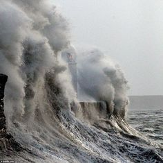 Raw power: Huge waves explode over the sea wall and light house at Porthcawl, which could be even harder hit this evening Fuerza Natural, Huge Waves, Giant Waves, Belle France, Sea Storm, Big Wave Surfing, Stormy Sea, Deep Blue Sea, Seaside Towns