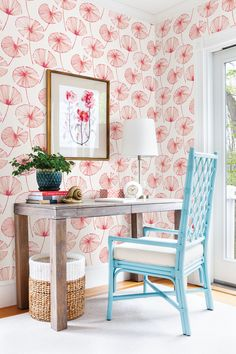 With this floral wallpaper, it will feel like summer all the time. Hot pink, bright orange, and flamingo pink are bright and lively. The palm leaf inspired print is full of movement that is accented by a painterly effect.