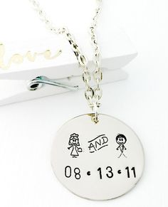 "This sweet silver filled necklace is great for your wedding day or as a memento your amazing day!    The 1"" silver filled disc has been stamped with these new and exciting bride and groom metal stamps. Each disc not only has the Bride and Groom but  I will hand stamp the date of your wedding on it as well.    You have the option of adding some crystals to this as well.  You might want to add both of your birthstones.  You can add them by just clicking here…"