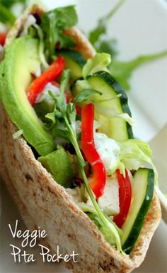 Hummus, red pepper flakes, avocado, pepper, cucumber, pecorino romano, red bell pepper, pita