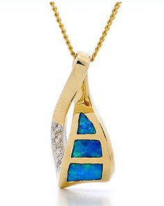 A one of a kind design pendant.  This pendant features three stunning solid inlay opals, sourced from quality opal mines in Coober Pedy, South Australia, crafted in 14k yellow gold to create a beautiful jewellery item. The pendant is enhanced by brilliant cut diamonds.   The colour of the opal of this pendant makes this piece a unique addition to your jewellery collection. Made for lovers of designer jewellery #opalsaustralia