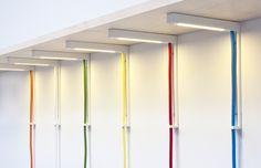 Lightbracket lamp from AlexAllen Studio supports a shelf like a bracket and illuminates the space underneath.