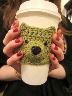 This cute #handmade crocheted bear cup cozy will keep your paws warm this winter, while giving you the most adorable coffee cup at the same time! For anyone who always has a hot drink in their hand this is the perfect gift - even for yourself! Simply keep in your bag for those quick trips to the coffee shop, and slip onto whatever size cup you fancy. No more cardboard sleeves going into the waste! #cupcosy #bearcupcosy #cupcozy #coffeesleeve