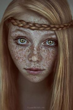 Freckles. Wow she is gorgeous...I love this portrait!