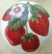 strawberry cabinet knobs - I would certainly love these to put on country white cabinets!