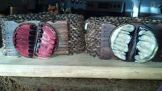 Resin buckle on stretch belts. The belts are made with beads stamped out of coconut shells.