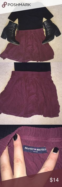 Brandy Melville Maroon/Burgundy Heather Skirt A classic skirt in a classic color! It's got a stretchy waistband that typically fits XS through M, but it's marked one size. It's in great condition with no flaws. Shirt in picture also available in my closet, as well as a few more Heather skirts in different colors. Comment with any questions—and don't forget the bundle discount! Brandy Melville Skirts Mini