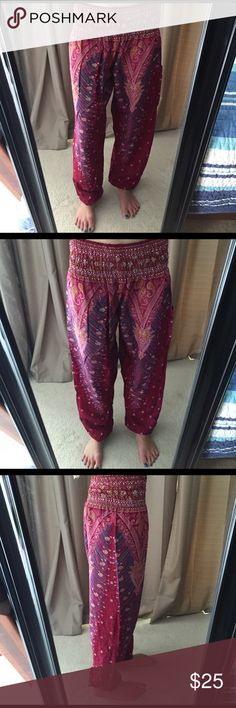 HAREM PANTS boho gypsy purple genie peacock beach Harem pants. Size small. Made in Thailand. Pocket on the one pant leg. Smocked elastic waist. Elastic at ankles. Baggy loose fit very comfy. Lightweight fabric perfect for warmer climates. Brand new with tags. Peacock purple pattern. Size small 0-2. 💕 If you have any questions please ask. Pants Track Pants & Joggers