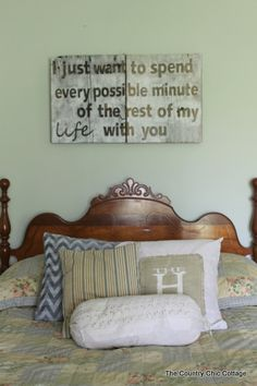 hunger games love quote barn wood sign shown over bed