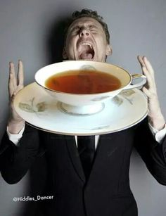 Tom Hiddleston ...and his cup of tea - look at all that lovely Earl Grey tea (btw, that's his favorite flavor!)