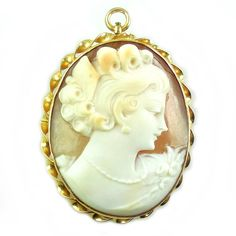 Antique Art Deco 10K Gold Carved Shell Cameo Pendant/Pin. This is a stunning piece of artistic jewelry, as are most natural carved antique cameos.  Check out more antique and vintage jewelry at Regalities.com, or visit this link to view this item: http://regalities.com/product/antique-art-deco-10k-gold-7-5gr-carved-shell-cameo-pendant-pin-swivel-bale-thick-and-well-made/