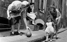 Bringing up baby, on the streets of London's East End in the 1950s.